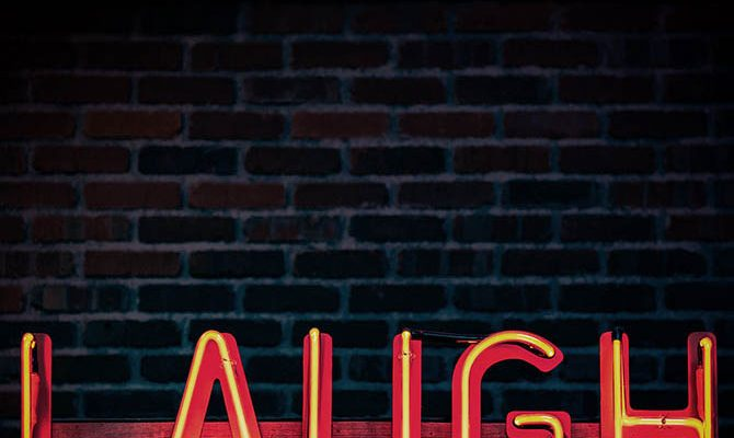 "Neon sign saying ""laugh"""